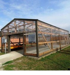 A great pic from our crew as they finished up an old steel covered pole barn into a greenhouse for the program at Walnut Ridge High School in Arkansas. Greenhouse Farming, Build A Greenhouse, Greenhouse Growing, Greenhouse Ideas, Greenhouse Film, Portable Greenhouse, Backyard Greenhouse, Greenhouse Wedding, Large Greenhouse