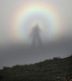 """A rare optic sight, the ""Brocken spectre,"" which occurs when a person stands at a higher altitude in the mountains and sees his shadow cast on a cloud at a lower altitude."""
