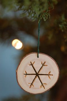Snowflake Christmas ornament cut with a dremel.