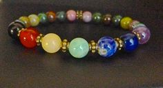 This lovely 7 Chakra gemstone bracelet is made with crystals believed to help with balancing the chakras. The purpose of wearing a chakra bracelet, beyond the evident beauty of the gemstones used, is