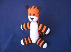 adorable little stuffed hobbes! not too difficult or time consuming until you get to the stripes! definitely use fleece instead of plain cotton...you don't have to worry about the edes!