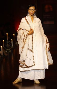 A model presents a creation by Meera and Muzaffar Ali at the finale of Bangalore Fashion Week in Bangalore, India, Sunday, July 29, 2012.