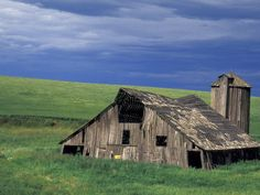 size: Photographic Print: Wooden barn and silo, Lewiston, Idaho Poster by Darrell Gulin : Wooden Barn, Rustic Barn, Wooden House, Old Buildings, Abandoned Buildings, Abandoned Places, Country Barns, Country Life, Lewiston Idaho