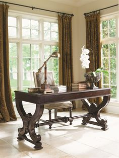 Decorative with the right amount of storage space for small items, this writing desk shows off serpentine legs, a fluted stretcher and acanthus leaf carvings that allow it to be the perfect piece for your home office space that may be smaller in size.