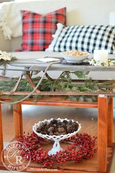 Needing a coffee table for a Christmas party, this vintage sled was repurposed to provide space for food and drinks while providing festive vintage charm || Ruffles and Rifles