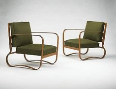 Jacques Adnet  					lounge chairs, pair      					  						HermesFrance, 1950s leather over iron, upholstery24 w x 27 d x 29.5 h inches An excellent example of Adnet lounge chair design.  Literature: Les Decorateurs des Annees 50, Favardin, pg. 18 (pictures a related design from the same series), s10.3