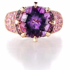 This beautiful Le Vian 14k rose gold and black rhodium ring, features round cut amethyst, pave set, of exquisite color weighing 7.13 carats total.