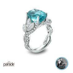 A Nina Garcia Platinum must-have. Parade Design meandering diamond-set vines and leaves showcase a watery blue Paraiba tourmaline.