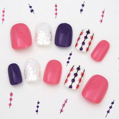 Love the color scheme of the nails! Pink dark purple and white