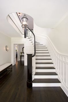 love the moulding and dark rail and step treads. Same shape as our staircase. Traditional Staircase Design, Pictures, Remodel, Decor and Ideas Best White Paint, White Paint Colors, Neutral Paint, Wall Colors, Traditional Staircase, Staircase Design, Staircase Molding, Curved Staircase, White Staircase