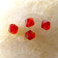 '100 pieces Red Bicone Beads 4x4' is going up for auction at 12pm Mon, Nov 12 with a starting bid of $5.
