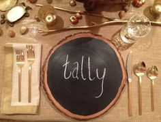 rustic wood sliced chargers, painted with chalk paint. Used as place cards,  write a festive message or write the menu being served.
