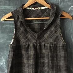 the West Water Tunic made by Karyn Valino of Make Something. ::   This #westwatertunic came together beautifully! Plaid linen from @sultansfinefabric with yoke pieces cut on the bias and trimmed with #libertyoflondon Mirabelle