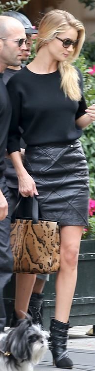 Rosie Huntington-Whiteley: Shoes – Isabel Marant TACY SUEDE AND CALF HAIR ANKLE BOOTS  Purse – Giorgio Armani  Sunglasses – Oliver Peoples  Skirt – Loewe x Junya Watanabe