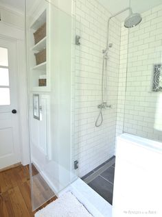 Walk-in shower with rainfall shower and linear drain