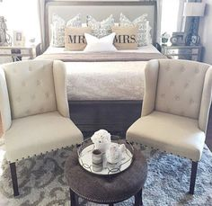 these tufted chairs are perfect in this master bedroom
