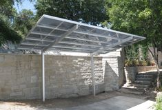 Premium-quality modern carports & awnings for residential & commercial applications. Our innovative products are made of maintenance free aluminum & stainless steel. Carport Shade, Carport Canopy, Metal Carport Kits, Carport Garage, Patio Design, House Design, Modern Carport, Car Canopy, Steel Carports