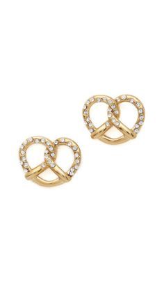 Pavé crystals add a salted look to these pretzel-shaped, gold-plated stud earrings. Post closure.Gold plate.Imported, China.MeasurementsLength: 0.5in / 1.5cm