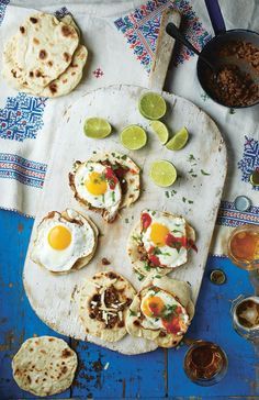 Refried beans, fried egg and chilli salsa tacos