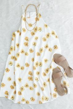 white yellow floral halter dress, spaghetti strap, daises, sunflower, flowers, flowy, spring, short // The Copper Closet, fashion, boutique, clothing, affordable, style, woman's fashion, women fashion, online shopping, shopping, clothes, girly, boho, comfortable, cheap, trendy, outfit, outfit inspo, outfit inspiration, ideas, Jacksonville, Gainesville, Tallahassee Florida, photo shoot, look book