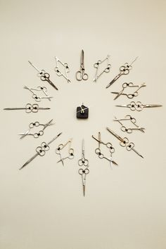 Scissor clock in hair salon, with vintage shears. Up high of course.