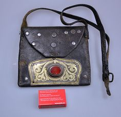 Turkmen leather bag with silver and carnelian stone.