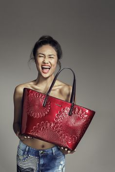 This Shiny Black Shopper Bag Will Keep You On Your Feet!