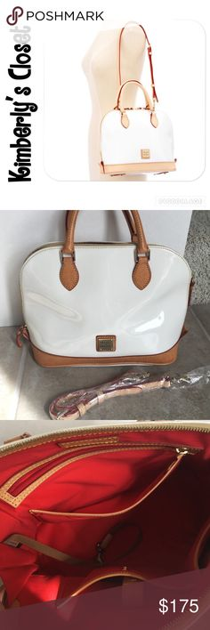 """✨DOONEY & BOURKE✨ handbag DOONEY & BOURKE handbag features rich cowhide coated with white high shine surface. Modern dome shape satchel. Tan leather trim. The optional shoulder strap provides you with styling versatility.  H 10"""" x W 5"""" x L 12.75"""". 2 inside open pockets, 1 zip pocket. Cell phone pocket. Inside key hook. Handle drop length 4"""". Strap drop length 15.5"""". Adjustable detachable strap. Red accent lining. Zip closure. Gently used-very good condition. Very small pen mark on back…"""