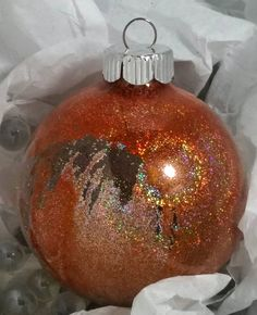 Rich orange hand-painted glass ornament.  I'm loving the rich color and sparkle.  you can get them directly from me just contact me! $20  $5 shipping.  They're painted on the inside!  They come securely packed in a box within a box.  I wanted to make it super easy for you to give them as gifts.  Of course they may be the perfect color for your holiday decor!  #ornaments #handmade #orange  #christmasornaments #christmas #artdecor #interiordesign #upscale #shopping #uniquegift #oneofakind…