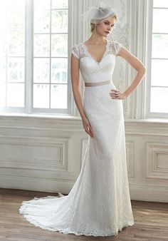 Lace sheath dress, complete with illusion lace back and cap-sleeves | Maggie Sottero | https://www.theknot.com/fashion/audrianna-maggie-sottero-wedding-dress