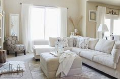 stylish-neutral-living-room-designs-white-sofa-pouffe-cushion-fur-rug-desk-lamp-and-curtain