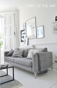 ♥ grey couch. I love the fact that my Roomba can fit under this. This would be fabulous for my tiny living room!:)