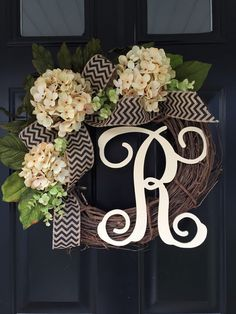 3 buttercream hydrangeas , a mix of leaves and light green boxwood surround a black chevron cascading bow . this wreath is perfect for spring , summer and fall !! this would make a wonderful gift for someone special . add a monogram in either of my 3 fonts in cream or black . i cant decide which color i like better ! the cream gives it such a pretty country feel and the black a more sophisticated look . i attach the monogram with thin wire and cover it with jute string to add to the look of…