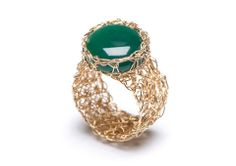 Handmade gold filled knitted mesh ring with with high set stone.  http://www.pennylevi.com/