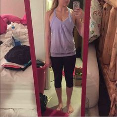 Purple Lululemon Top!! Beautiful Purple Lululemon top. Only worn once! Too small for me. This specific style is very hard to find because it is discontinued! Size 2! (AVAILABLE FOR LESS ON ♏️) lululemon athletica Tops Tank Tops