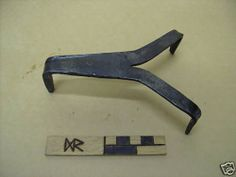 """viking mastermyr trivet  a hand forged copy of the trivet from the mastermyr hoard, gotland ,sweden, 1000AD, nominally 6"""" long and 1"""" tall, made in sheffield england by daegrad tools"""