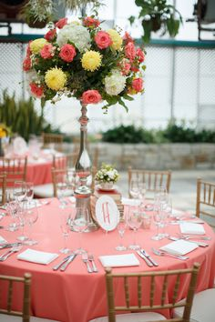 Elegant peach and coral wedding reception setting