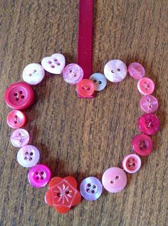 Delicious little button wreath made using the wire netting around a wine bottle and threading it through the buttons !