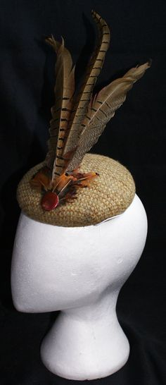 Pheasant Feather fascinator / head piece for by GwinnuttMillinery