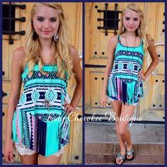 """https://instagram.com/ladycherokeeboutique Shades of You MINT & NEON PINK MULTICOLOR FRINGE TRIBAL PRINT TANK ✨Chandler is wearing a Small✨  Price: $28.00, Free Shipping  Qty: 2 small, 2 medium, 2 large  Please comment """"Sold"""", State, Size, and quantity needed, as well as your email to purchase.  Also, you must let us know what state you live in, before we can invoice you!"""