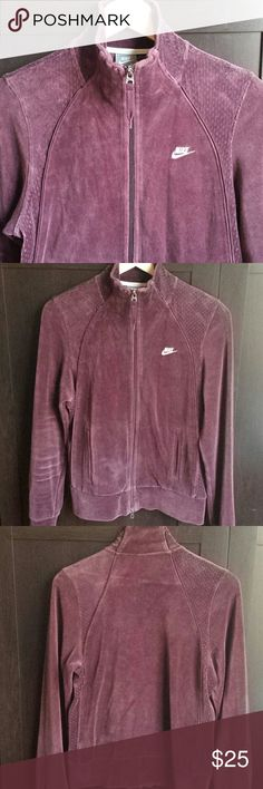 Nike Velour Full Zip Track Jacket Sporty Nike Velour Full Zip Track Jacket in soft maroon w/ Nike logo/print on chest. Feels soft, light and keeps you warm. Includes front pockets and has some air holes for ventilation on side panels. Hidden pockets on inside as well. There appears to be some slight discoloration near right pocket possibly due to the velour fabric as seen in pictures. In good, used condition. Nike Jackets & Coats