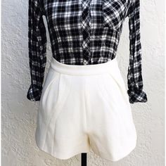 """Finders Keepers White Peplum Flare Shorts Finders Keepers White High-Waisted Shorts. Peplum, Flare Silhouette and Origami Fold Front Pleat Detail. The Shorts feature a Textured Triangle Cotton Print. Zipper Back and Hook-Eye Closure. Size Small, Waist 27"""", or US Size 4. Brand New, Never Worn. The plaid top is also for sell as well. Finders Keepers Shorts"""