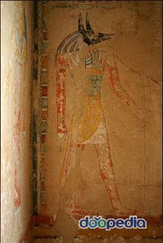 """아누비스 Anubis  이집트어 -> 인푸 """"Inpou""""를 그리스어로 발음한 것.  태양신 라 Ra의 넷째아들로 표기.  후대 -> 오시리스와 네프티스의 아들로 나타남.  저승으로 향하는 문을 열어 죽은 자를 오시리스의 법정으로 인도.  죽은자의 심장을 저울에 달아 생전의 행위를 판정하는 역할을 맡음.  주로 검은 표범 또는 개의 머리, 혹은 피부가 검은 남자의 모습 또는 자칼의 머리를 한 남자의 모습 등으로 표현."""