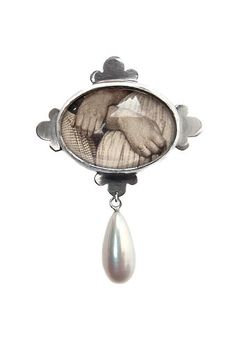 'Oblivion', 2014, brooch. Silver, glass, old postcard, fresh water pearl. Made by Malou Paul