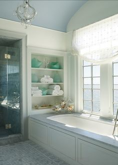 Bathroom Design. This is not a big bathroom, but the interior designer used the space wisely with nooks and with large windows. #Bathrroom