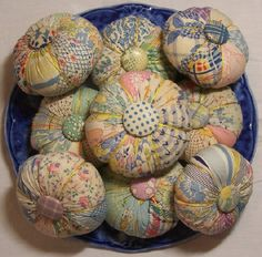 Pincushions made from vintage feed sack and cotton fabric.