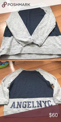 VS Angel NYC sweatshirt Mint/New condition. Super comfy! Victoria's Secret oversized color-blocked sweatshirt. Size small. Victoria's Secret Tops Sweatshirts & Hoodies