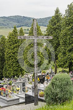 The cemetery in the small village Roznow near Krakow in Poland. Big wooden Cross.