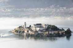 A fairytale island floats in the middle of Italy's little-known Lake Orta. Isola San Giulio – Isola San Giulio, Italy - Atlas Obscura