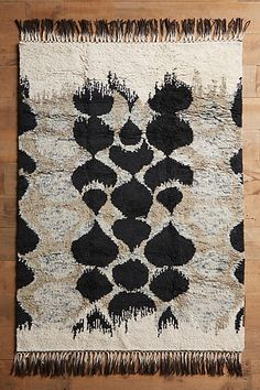 I prefer a flat-weave rug for the living room but I can't help but love this rug's color and texture